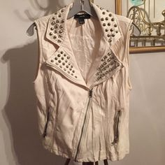 White Patton leather vest Edgy rocker vest. Made of a Patton leather material. Lines with a soft polyester. Material is suppose to be wrinkly. Only wore once. I am accepting offers Forever 21 Jackets & Coats Vests