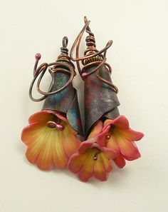 Pendants by malodora,. (Very different.  I like it when artists make their own bead caps/cones/etc.)