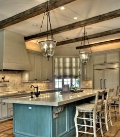 really like the rustic blue with maybe a bright white cabinet and THOSE BEAMS!