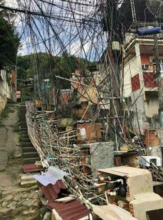 Electrical wiring and water pipes in a Brazilian favela.