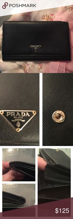 Prada saffiano wallet. A little reluctant to sell this...It was my mothers. It was used and loved by her. I'm certain it is authentic despite the fact that I couldn't find the original box or any paperwork on it when we went to clean out her things. The snaps have Prada name stamped on them and it was made in Italy. Some wear (pic 3) showing on the corners where it folds as well as a small area unstitching on one side of gusset. Fixable by a skilled craftsman. I think this is an older model…