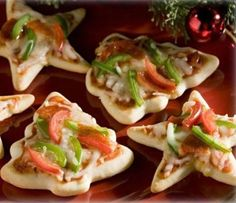 use holiday cookie cutters on pizza dough ♥♥ to make super cute and festive mini pizzas!