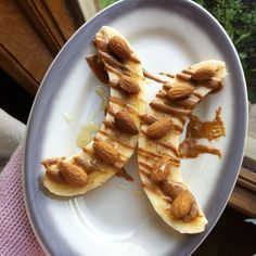 One of my favourite snacks ?????? Banana topped with almonds, almond butter, and blueberry blossom honey