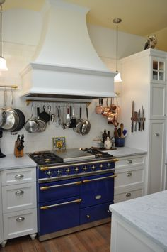 Beautiful blue stove.  Copper pots.