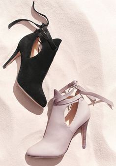 A sleek silhouette, curvy topline and side cutouts lend sophisticated allure to almond-toe booties made from smooth leather, while laces that crisscross and tie at the back are a casually chic detail. Next Shoes, Women's Shoes, Jimmy Choo Shoes, Shoe Closet, Smooth Leather, Abundance, Designer Shoes, Wealth, Almond