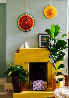 Farrow & Ball Babouche Painted Fireplace. Yellow and Green paint color scheme interior.
