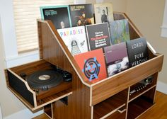 Handmade record and vinyl collection display storage cabinet shelf made by the Hi-Phile Record Cabinet Company in Portland, Oregon. Clever stuff.