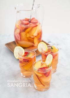 Imagine serving this strawberry peach sangria at a garden brunch, maybe at a Palm Springs pool party, or more realistically, the next time my friends and Party Drinks, Fun Drinks, Alcoholic Drinks, Beverages, Peach Sangria, Cocktail Recipes, Cocktails, Drink Recipes, Meatloaf Recipes