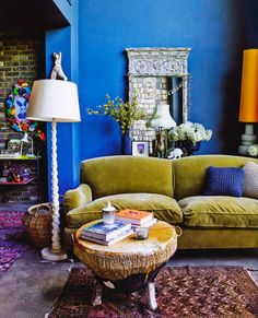 Boheme, living room, blue wall cerulean, green velvet sofa, stump coffee table, knit pillow, bohemian