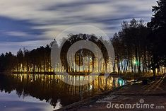 Photo about Backlight behind trees. Reflection on water. Image of natural, moving, photography - 108149462
