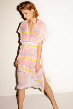 The Lelaga Patio Dress is a gorgeous, sheer cover-up that's made for long days at the beach and pool-side parties!