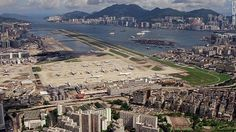 Hong Kong - Sitting partly in the city and partly in the sea, Kai Tak International Airport was one of the world's most exciting (and terrifying) airports to fly into. Kai Tak Airport, Travel Outfit Spring, Travel Baby Showers, Airport Photos, Airplane Travel, International Airport, Hong Kong, Paris Skyline, City Photo