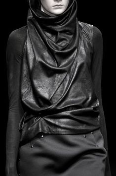 Draped leather top; layered black fashion details // A.F. Vandevorst