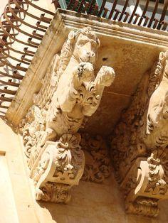 Noto - Balcony Horses    Location Noto, Sicily, Italy