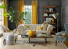 Eclectic living room with gray walls and yellow drapes