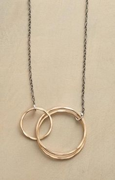 Chic and versatile, this golden rings and sterling links necklace will hardly get a moment's rest.