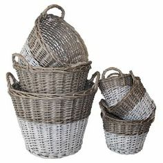 """Artfully woven, these willow baskets are washed in a gray finish and showcase painted white bottoms for a bold touch.  Product: 6 Assorted basketsConstruction Material: WillowColor: GrayFeatures: Two twisted ear handlesDimensions: 14.25"""" H x 19"""" Diameter (largest)"""