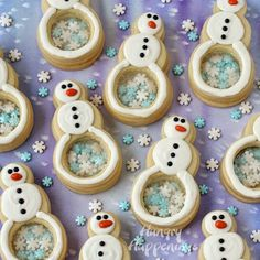 Snowman Cookies with Candy Bellies filled with Snowflakes   http://www.hungryhappenings.com