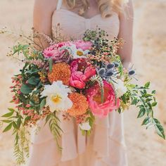 Loving this big + beautiful peony bouquet from Ann-Marie and John's playful rustic fiesta wedding!