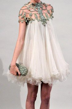 "This goes with your fruitcake dress collection, Andrea, like the ""fairy"" dress covered in butterflies..."