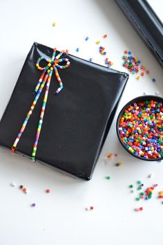 """~Fantastic """"ribbon"""" made from multi-color Peeler beads strung on a cord~ Wrapping Ideas, Creative Gift Wrapping, Present Wrapping, Christmas Wrapping, Diy Christmas Gifts, Gift Wrapping Techniques, Birthday Gift Wrapping, Gift Wraping, Gifts For Kids"""