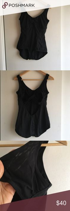 Worn once Lululemon black leotard, size 8 Lovely Lululemon open back with mesh crisscross black leotard, size 8- worn one time.  Low-cut leg, fully covers backside.  Moisture-wicking Luon material.  Comes from a very clean, non-smoking home.  Size tag has been torn out (as with most Lululemon pieces), but because all of my articles of clothing are my own, and purchased by me, I can assure you it is a size 8! lululemon athletica Swim One Pieces