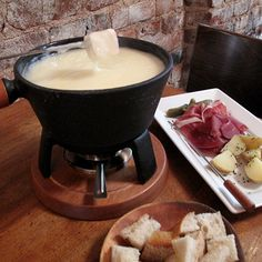 Fondue saw its American heyday in the 1960s, when themed parties centered around mid-century fondue sets were all the rage. But does melted cheese ever really go out of style? Meewes