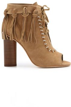 How to wear fall's fringe trend: fringe boots. Shop one of our 20 favorite pairs for the season: