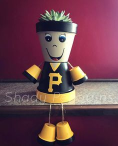 Excited to share this item from my shop: Pittsburgh Pirates Flower Pot Boy /clay pot people/football/terra cotta/home decor/custom made/hand painted/sports fan/sports memorabili Flower Pot People, Clay Pot People, Clay Pot Projects, Clay Pot Crafts, Flower Pot Crafts, Flower Pots, Flowers, Painted Clay Pots, Hand Painted