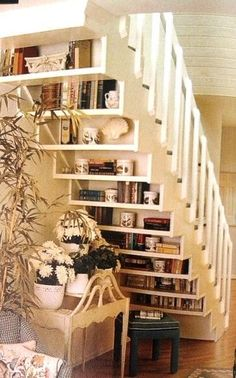 bookshelves behind stairs - very cool!
