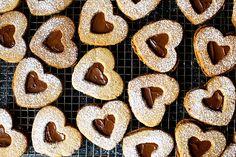 chocolate hazelnut linzer hearts from smitten kitchen - my favorite cookies! Cookie Desserts, Just Desserts, Cookie Recipes, Delicious Desserts, Dessert Recipes, Yummy Food, Recipe Treats, Cookie Ideas, Tasty