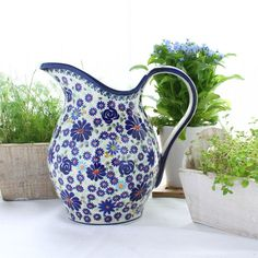 Handmade and hand-painted pitcher. Polish pottery is world renowned for its distinctive cobalt blue design and high durability, making it a must have for your kitchen. Every product is unique, being individually handcrafted to reflect a combination of the strength and beauty so characteristic of Polish folk art. Create your very own collection by choosing from the extensive variety of patterns and colours available. Available from http://thechouchou.co.uk/