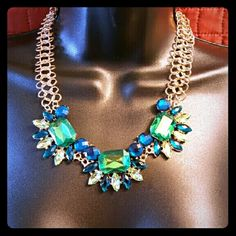 Green/Blue Fashion Necklace Beautiful necklace to dress up any outfit! Green and blue colored glass crystals on a gold tone chain.   I have 4 total of these. If you'd like to purchase more than one I can create another listing for you then you can bundle and save 20%! Iconic Legend Jewelry Necklaces