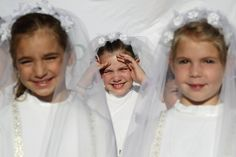 Young girls hope to meet Pope Francis during his general audience on Wednesday in St. Peter's Square at the Vatican. Evandro Inetti/Zuma Press