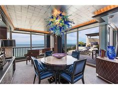 2385 GULF SHORE N #701, Naples, FL 34103 | Gorgeous breakfast table with an ocean view.  The chandelier's not bad either.