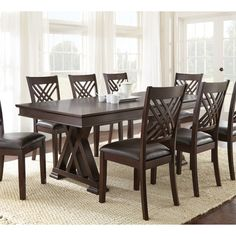 The Adrian Dining Room Set by Steve Silver Furniture offers elegant dining in a transitional style. The collection is constructed using hardwood solids and primavera veneers in durable multi-step hand applied glazed merlot cherry finish. Dinning Table Design, Solid Wood Dining Table, Extendable Dining Table, Wood Table, 7 Piece Dining Set, Dining Table In Kitchen, Dining Room Sets, Colored Dining Chairs, Traditional Dining Tables