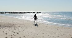 """New York's surfers don't do an """"off season"""" at Rockaway Beach, taking to the waves in near-freezing temps; surfing community helped after Hurricane Sandy."""