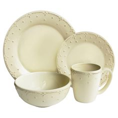 Offering charming appeal for your dining room table, this lovely earthenware dinnerware set features service for 4 in a cream finish.  ...