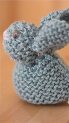 These are the easiest knitted bunnies! Learn How to Knit a Bunny from a Square with Video Tutorial by Studio Knit. #StudioKnit #knittingvideo #bunny #knittedsofties #howtoknit
