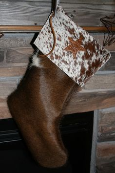 Cowhide Christmas.... I will have similar stockings for sale November 2016.