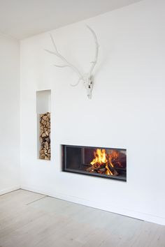 modern fireplace with deer antlers