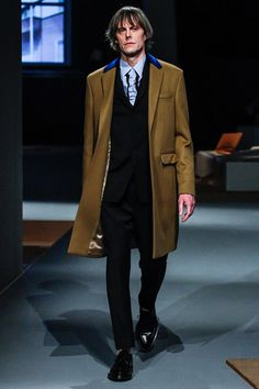"""FALL 2013 MENSWEAR  Prada /  While you reflect on Miuccia Prada's comment that she considered the presentation """"one of the most sophisticated I've ever done."""" Surely she was having us on. As Miuccia went on to explain herself, her logic became clear. """"Simplicity is so difficult. To make perfect something that is normal and classic is much harder."""" And make no mistake, Prada was in pursuit of perfection this season."""
