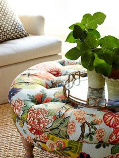 Home Interior and Design | I love this idea for choosing an upholstered ottoman over a more traditional coffee table. It's safer for crazy kiddos, more comfortable for propping up your feet, and perfect for adding a pop of color and pattern!