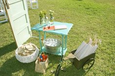 """Outdoor wedding sign-in """"table"""" and accessories- love the mosquito spray... LOL"""