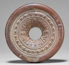 This is a ring stone from the Maurya Empire. Ring stones were very important sculptures in India's history.