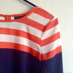"""orange and navy nautical top NEW! Perfect for a day by the water! This preppy sailor top is classy and goes with anything! Small white powder stains near bottom of shirt and one on the side, priced accordingly! Size S. Waist fits 28-32"""". Hips fit 36-40"""". Bust fits 36-40"""". 100% polyester. Also featured as a host pick for the 11/6 City Chic party and the 7/27 Statement Style Party! 🎉 Worthington Tops"""