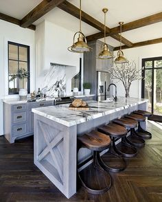 Open concept kitchen with modern light fixtures and black and white granite countertops and backsplash White Wash Cabinets Kitchen, Kitchen And Bath, Country Kitchen Counters, Kitchen Reno, Home Decor Kitchen, New Kitchen, Interior Design Kitchen, Kitchen Remodel, Rustic Kitchen