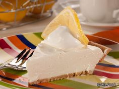 Lemon Pie? Oh My! - 4 ingredients and you've got a creamy lemon pie that's out of this world. No baking involved!