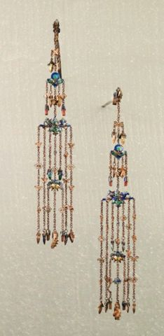 In 1644, the Aisin-Goro clan of the Tungusic Jurchen people from Manchuria (now Northeast China) conquered the Han Chinese in the South. The Ming Dynasty gave way to the Qing Dynasty. These are Qing Dynasty silver hair pins made during the reign of the Guangxu emperor Aisin-Gioro Zaitian (1875 – 1908). He was the Dynasty's 11th and penultimate emperor.