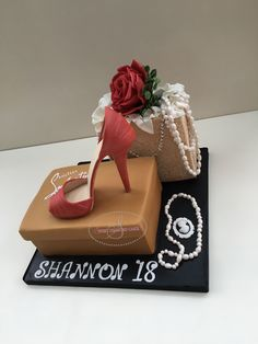 Simply elegant and chic Louboutin shoe box and shopping bag cake for Shannon's 18th birthday. Www.sweetdiamondcakes.co.uk